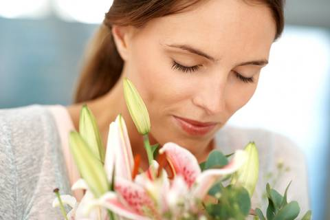 Women smelling flowers