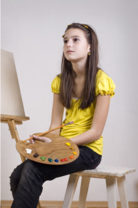 Girl learning to be more creative